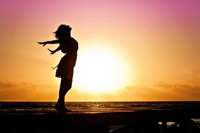 woman-happiness-sunrise-silhouette-larger